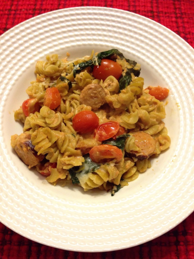 Pasta bake with chicken sausage, mozzerella, spinach, and cherry tomatoes